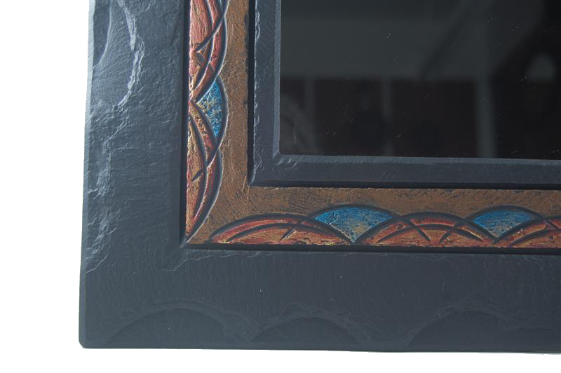 detail on a ornate overmantel mirror