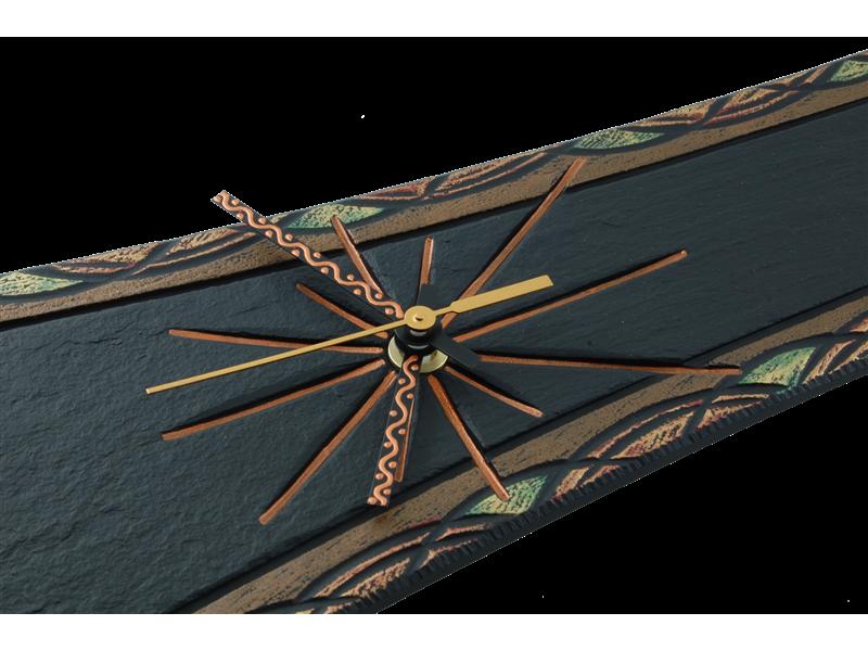 details-on-an-ornate-pendulum-clock-medium