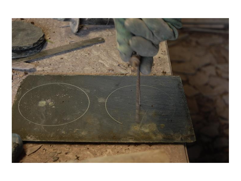 drawing out the outline on slate