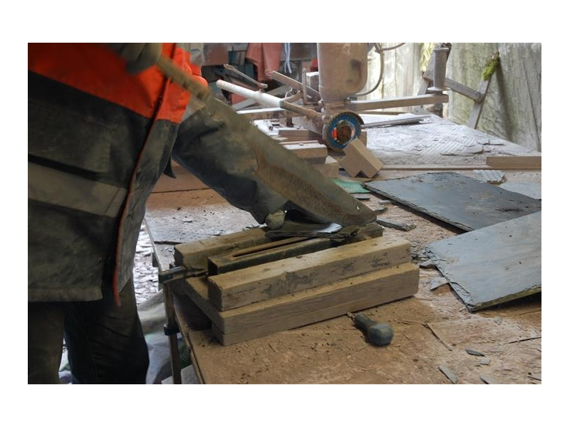 hand cutting slate.